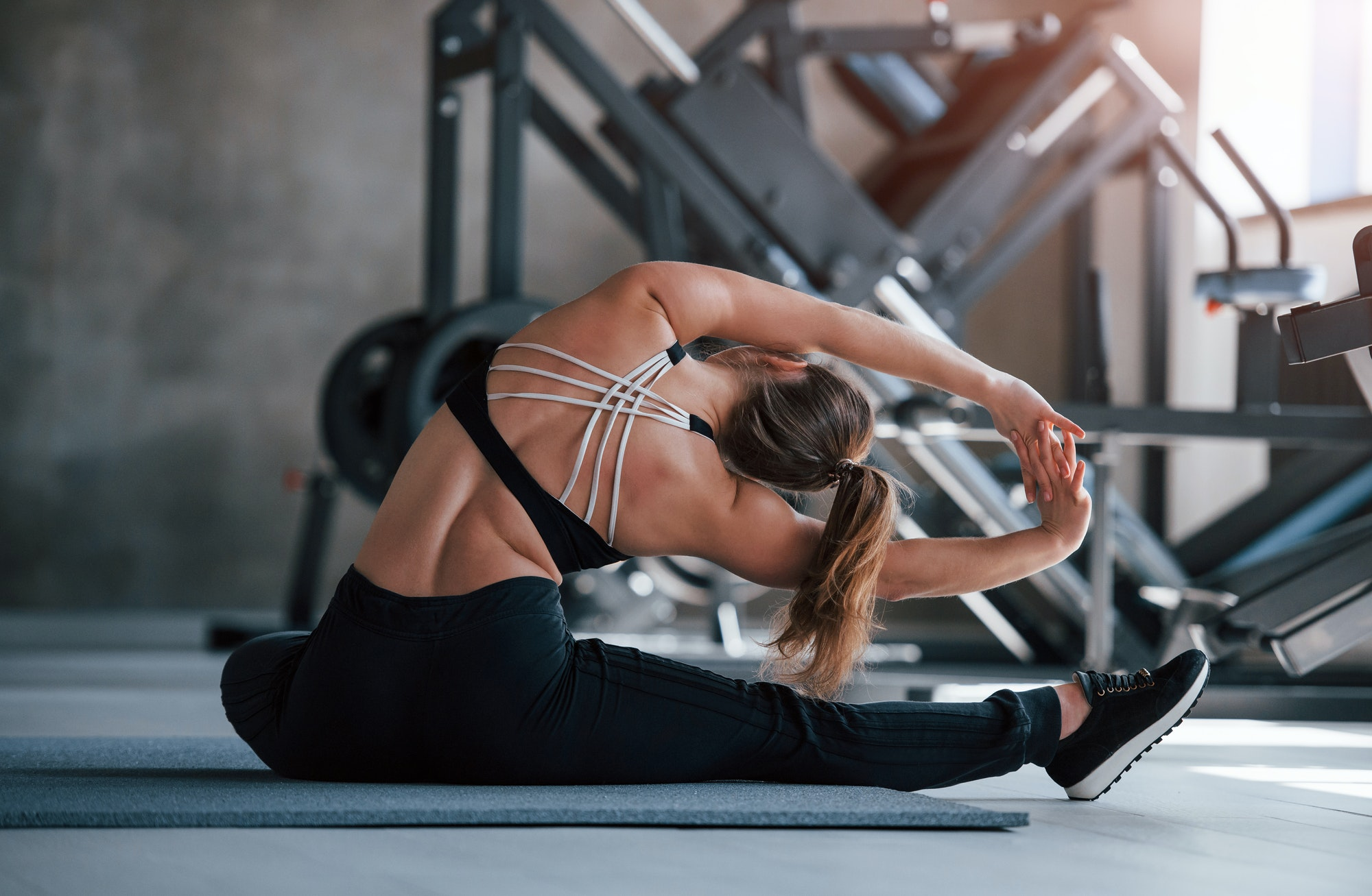 Yoga stretching. Photo of gorgeous blonde woman in the gym at her weekend time